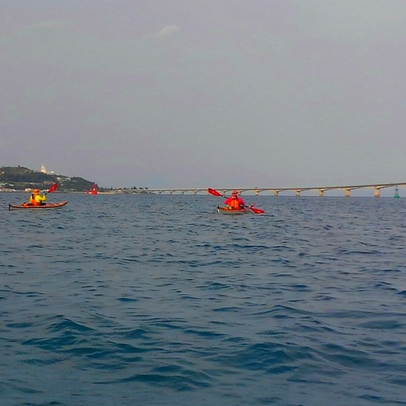 two kayakers paddling near Kouri Island